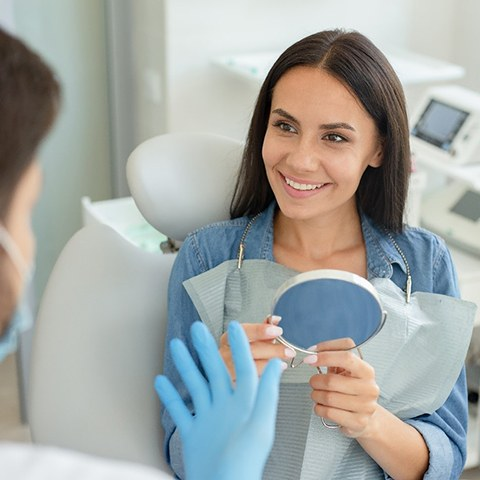 Patient smiling while talking to cosmetic dentist in Texas City
