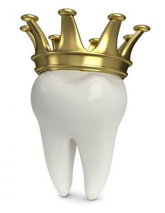 white tooth with golden crown