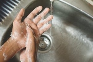 dentist in Texas City washing hands