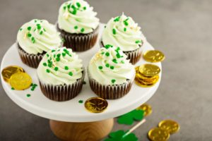 tray of st. patrick's day decorated cupcakes